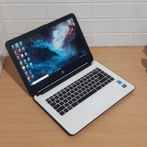 HP 14-AC005TX Intel® Core™ i3-4005U RAM 4GB SSD 128GB + 500GB HDD, VGA AMD Radeon™ R5 M330, slim putih elegan